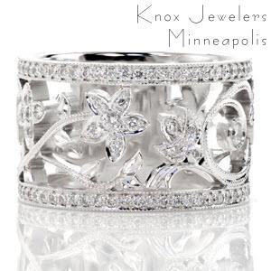 Filigree wedding band in Montreal with nature inspired patterns between diamond bands.