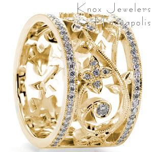 Unique custom wide band ring in El Paso with bead set diamond rails surrounding a diamond set floral designed center.
