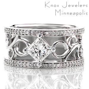 The kite-set 1.00 carat princess cut diamond draws the eye to the center of the design. Hand wrought platinum filigree curls add movement to contrast the straight lines of the square stone. Micro pavé line each side of this signature wide band for flashes of fire and sparkle.