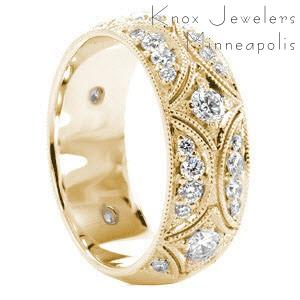 Wide band wedding ring in Sarasota with diamonds and intricate patterns.