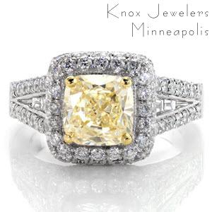 A magnificent halo design enveloped with micro pavé, this ring glimmers and shines from every angle. The center is a 1.50 carat fancy yellow cushion cut diamond set with an accent of yellow gold prongs. Channel set baguettes rest in the middle of the micro pavé. The design is framed with milgrain edges.