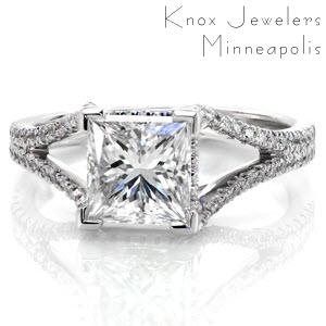 Design 2282 features a 2.00 carat princess cut center diamond in a split shank band. The band is detailed with two rows of micro pavé diamonds that flow smoothly towards the center stone. There are micro pavé diamonds accenting the sides of the center stone setting for that extra opulent touch.