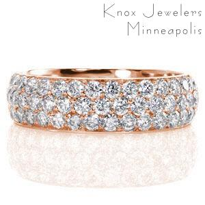 Montreal custom rose gold wide ring with a rounded band and three rows of micro pave diamonds.