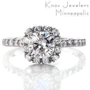 Halo engagement ring in Rochester with cushion cut diamond and cushion shaped halo.