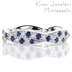 Crafted in 14k white gold, Design 2305 captures the rich, cobalt blues within its round sapphires. Alternating in arrangement, the round cut diamonds highlight the deep blue. The two woven bands are detailed with hand applied milgrain to bring the finest finishing touch.