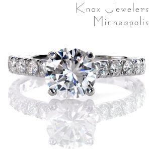 Allentown engagement ring with round brilliant center stone and diamond band.