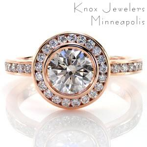 Custom created classic engagement ring with a bezel set round center diamond surrounded by a channel set diamond halo and diamond band in Grand Rapids.