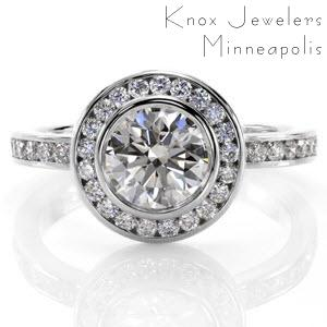 Custom created classic engagement ring with a bezel set round center diamond surrounded by a channel set diamond halo and diamond band in Bridgeport.