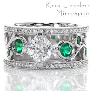 Vivid green emerald side stones are bezel set into the large scroll of the filigree pattern. The 1.00 carat radiant cut center diamond is kite-set to continue the flow of the filigree. A row of micro pavé adorns both sides of this wide band ring with milgrain texture to accent the edges.