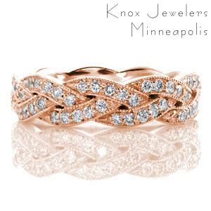 Rose gold wedding band in Boston with a diamond braided pattern outlined in milgrain.