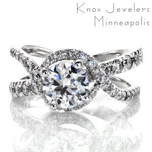This unique halo design has woven rows of micro pavé diamonds cascading over and under the delicate split band design. The diamonds flow around and under the four prong 1.00 carat center stone, adding movement and radiance. The design is exclusively Knox, and sure to make a statement.