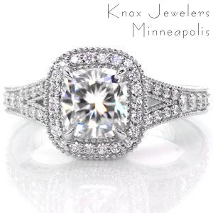 Custom engagement ring in New Haven with a cushion cut center diamond surrounded by a diamond halo and split band.