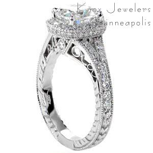 Antique engagement ring in Allentown with cushion cut center stone, filigree and diamond halo.
