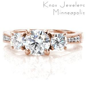 Tucson custom three stone engagement ring with a bead set diamond band and floral profile design.