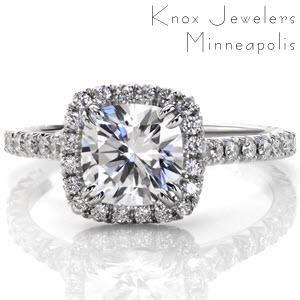 Baltimore halo engagement ring with cushion cut center stone and diamond band.