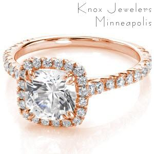 Detroit rose gold custom engagement ring with a micro pave diamond halo surrounding a cushion cut center diamond.
