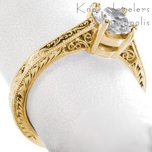 Washington D.C. filigree engagement ring with round brilliant center stone, hand engraving and milgrain.