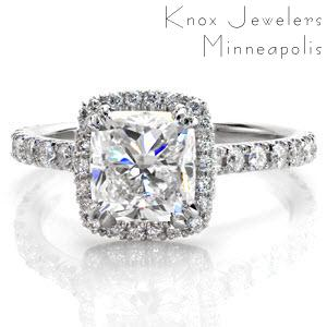 Halo engagement ring in Indianapolis with a cushion cut center stone and diamond band.