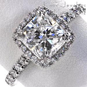 Halo engagement ring in Boston with cushion center stone and diamond band.