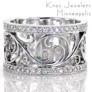 Flowing hand wrought filigree seamlessly flows within our Catalina design. The curving 14k white gold swirls form a beautifully balanced design. The curls are framed by two delicate  micro pavé diamond bands. The design balances polished metal work with glimmering diamonds for an eye catching piece.