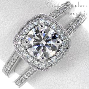 White gold halo engagement ring with two rows of bead set diamonds and cushion halo in Edmonton.