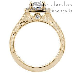Irvine custom engagement ring with a halo design and profile view featuring scroll engraving, milgrain and a bezel set surprise stone.