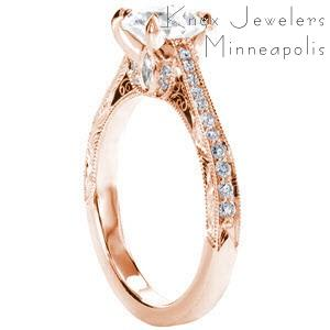 Unique rose gold engagement rings in Rochester featuring vintage engagement ring details. This beautiful ring has hand engraving on the sides along with hand formed filigree curls, and petals of diamonds. The top of the band is diamond set.