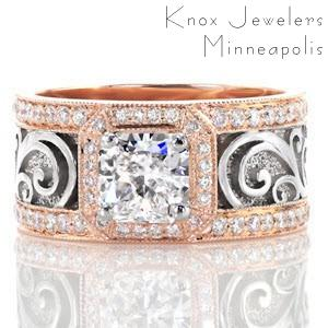 Warm 14k rose gold and crisp 14k white gold take center in the Jesse Design heirloom band. A bevel corner square halo of bright-cut and bead-set diamonds frame a 1.00 carat radiant cut center diamond. The wide band frames the flowing hand detailed filigree and a stippled background.