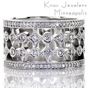 Royale is a wide band with pierced elements that create a unique and beautiful pattern. The design features rows of alternating star-bursts and circles finished with glimmering diamonds. The band is framed with rows of micro pavé diamonds that are embellished with a milgrain beaded edge.