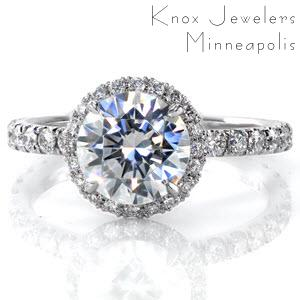 Halo engagement ring in New Orleans with a round brilliant diamond in a white gold setting.