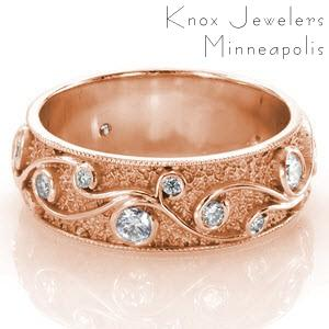 Tulsa rose gold wedding band with custom filigree curls, round diamonds and stippled background.