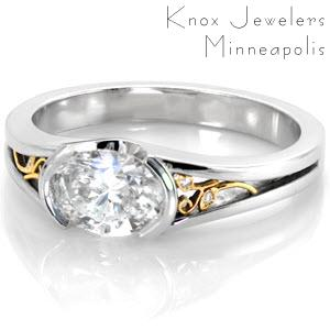 Filigree engagement ring with oval diamond set west to east in Memphis.