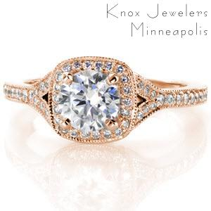 Rose gold engagement ring in Rochester with cushion shaped halo, round center diamond and split band.