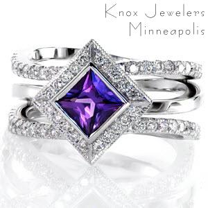 Design 2431 has two energetic bands of split bead set diamonds that frame a single high polished band in 14k white gold. The kite set natural 0.75 princess cut purple sapphire has a full bezel and outlined by a beveled square halo of bead set round diamonds.