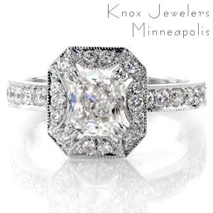 This glamorous design is shown with a 1.00 carat cushion cut center diamond in a claw prong setting. The halo has a unique starburst pattern cut-out around the center stone. The top of the band and the halo are exquisitely adorned with micro pavé and edged in milgrain for a refined finish.