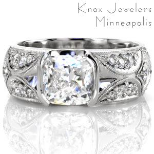 A mesmerizing design of dazzling star bursts accented with micro pavé on a wide band. Each section is edged in milgrain for a refined finish leading in to the 1.50 carat cushion cut center diamond. The center stone is set with a graceful half bezel which preserves the flow of the band's pattern.