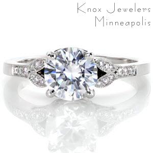 Oakland engagement ring with round brilliant center stone, filigree and micro pave diamonds.