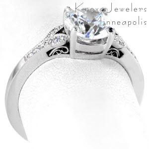 Antique engagement ring in Kansas City with round brilliant center stone, filigree and diamond band.