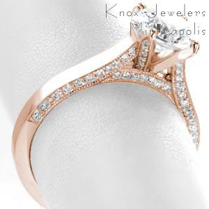 A perfect contemporary rose gold engagement ring in Ann Arbor! This breathtaking band features a high polished top, with micro pave diamonds adorning the side faces of the ring and the prongs.