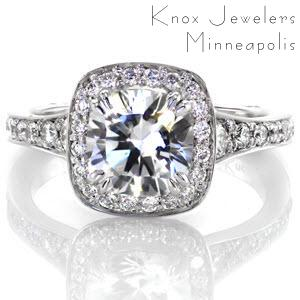 This contemporary design features a fashionable square halo and round diamond. The graduation of side stones creates a soft flare towards the top of the ring. A Euro shank is engineered to fit comfortably and prevent spinning. The surprise stones add that touch of elegance to the bottom of the band.