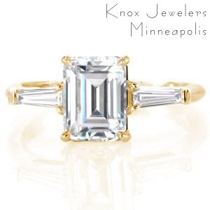 Custom engagement ring in Bridgeport with an emerald cut center diamond bordered by tapering baguette side stones.