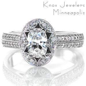 A scalloped halo design, embellished with micro pavé diamonds, accentuates the six prong .75 carat oval center stone. The diamonds continue and form a pierced diamond and crescent shape that is framed with milgrain detail. The diamonds continue on the band forming two rows of incredible brilliance.