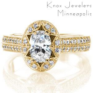 Custom engagement ring in Oakland with a uniquely shaped antique inspired halo surround an oval cut diamond