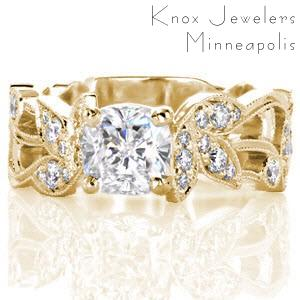 Unique, custom engagement ring in Salt Lake City. This Art Nouveau, ivy engagement ring design is shown in yellow gold with micro pave diamonds. The trellis setting of the center stone perfectly compliments the organic feel of the ring.