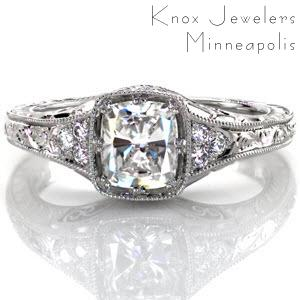 Antique inspired custom engagement ring in Richmond with a unique cushion cut center setting surrounded by bead set side diamonds and hand engraving.