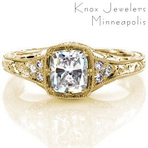 Antique inspired custom engagement ring in Schenectady with a unique cushion cut center setting surrounded by bead set side diamonds and hand engraving.