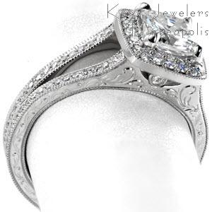 Beautiful split shank engagement ring in Miami, FL. This lovely cushion halo design features micro pave diamond in the halo and on the band. The sides of the band are elegantly adorned with hand engraving and surprise diamonds.