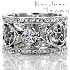 Unique filigree engagement rings in Charleston. This custom wide band engagement ring features a flowing filigree pattern down the center of the band. A kite set princess cut diamond center stone is the focal point of the piece, bordered by two micro pave diamond bands.