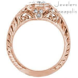 Custom rose gold engagement ring in Milwaukee with an oval center diamond and a unique hand engraved knife edge band.