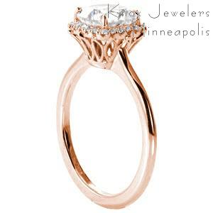 Rose gold custom engagement ring in Toronto with a cushion cut center diamond surrounded by a diamond halo.